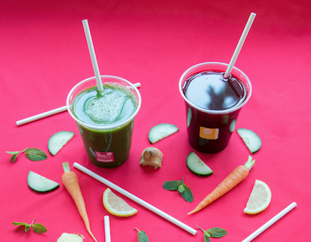 GREEN HOME paper straws inside cups of fresh vegetable juice