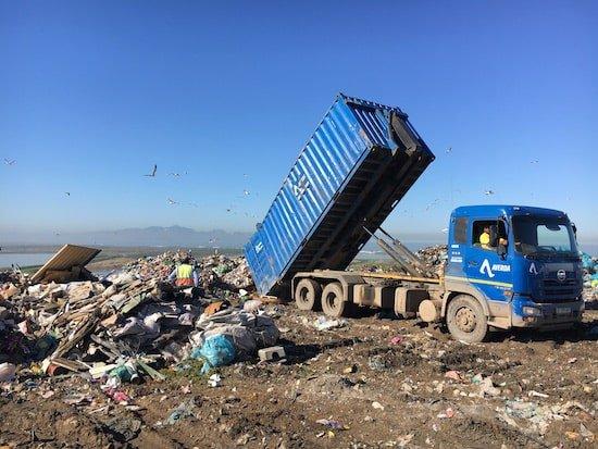 Tip truck offload trash