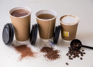 Three Hot Cups containing tea and coffee, with lids next to them