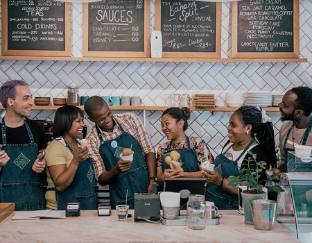 Staff laughing behind the counter at The Creamery