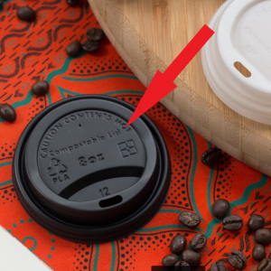 Photo of a Hot Cup Lid with an arrow to where it is embossed with the words 'Compostable Lid'