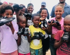 The Yiza kids holding their new school gear