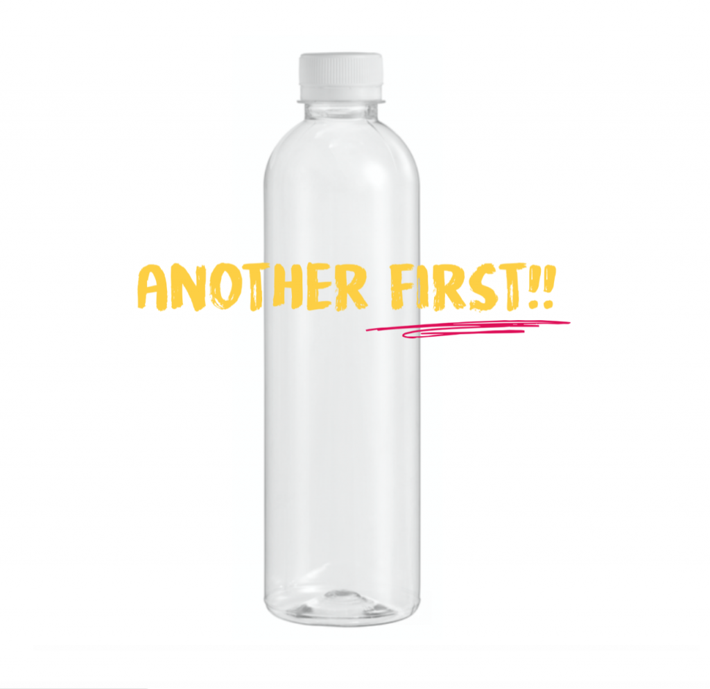Photo of a clear PLA plant-based bottle and lid with the words: another first