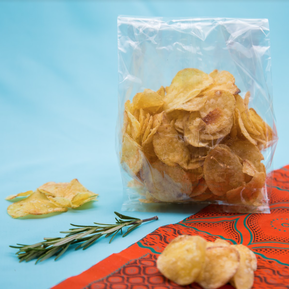 Clear bioplastic bag with crisps in it